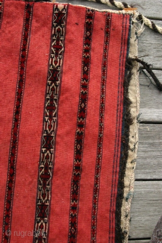 (11) Tekke Kizil Juval, 135 x 80 cm, 19th c. This big bedding bag has 9 finely and expertly knotted bands (two are white-grounded) on a blood-red, very robust flatweave with an  ...