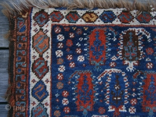{87} Afshar bag face, 57 X 45 cm, with 19 Boteh (4/5/5/5) and dragon main border. Some lost pile at either end and damaged selvages, but field intact. Great dyes.