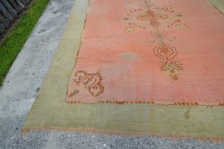 """Rare, extra large, circa 1930 Oushak or Ushak carpet with large central medallion on plain salmon field and accent colors of pale green, burgundy and yellow. All wool Size: 12'3""""W x 14'7""""L The variance in  ..."""
