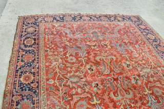 Large Heriz, wool on cotton, size 8'11 x 10'11, Has mostly nice pile with a couple of lower pile areas. Has a couple of old repairs and a small damaged area -  ...