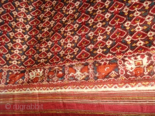 Patola Sari,Silk Double Ikat. Probably Patan Gujarat.India.This Patola Uses one of the most Rarely found designs.That of the Pipal leaf,known as Pan Bhat. This Rarely repeating pattern is combined with borders of  ...