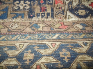 "Early 20th Century Lesghi Star Caucasian 3'11"" x 5'3."" Lovely blue colors and mix of natural and some synthetic dyes, but no color run. Very interesting and unusal major border. Wear and  ..."