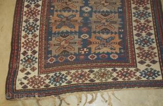 "Antique Kazak Caucasian rug in good low pile condition. Still has some of its original tassel endings. 4'6"" x 7'6."""