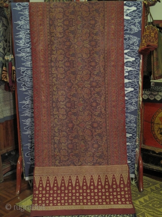 Kain Limar Salandang : Female Shoulder Cloth with elaborate ikat work of floral pattern. Both ends framed with supplementary weft work of golden threads featuring Tumpal design. From Malay ethnic group in  ...