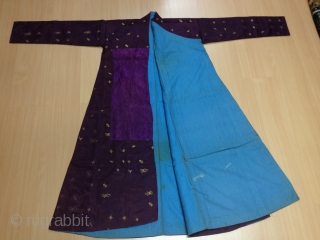 A male Tibetan Chuba (Male Robe), made from chinese damask brocade silk in deep purple color, all hand sewn. Brocade motifs comprise of dragons and phoenixes floating among the scroll of clouds,  ...