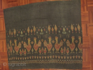 A weft ikat silk tube skirt from Northeastern part of Thailand. A lovely motif of roosters and chicks in repeating fashion on dark grey background. Est age 40-60 years. Wearable condition.   ...
