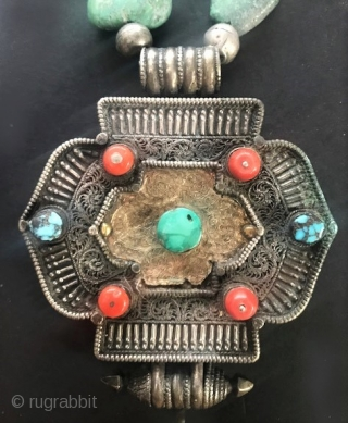 Turquoise gau necklace. Gau of silver, sheet gold , and coral. Tibetan beads and gau.