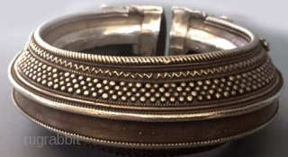 large silver anklet with granulation from Central India , worn as a bracelet for years , good age and also very good silver .