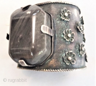 Three stone massive cuff with jet, rose quartz and Dalmatian stone, silver , art deco period from Mexico. Cuff opens with a pin.