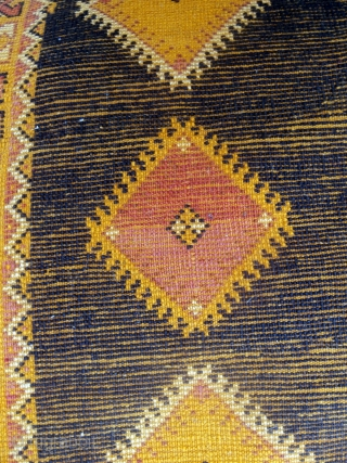 This exceptional piece was found in Tazenacht and is from the nearby Ait Ouaouzguite Berbers. The individual floral designs seem to float on the depth of background indigo. It is old and  ...