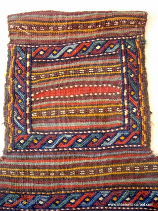 KURDISH SALT BAG. An exceptionally finely worked bag with an interesting reverse. There are four knots of magenta wool which simulate beads for good fortune woven into the face. It is from  ...