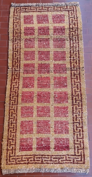 Absolutely unusual and rare Tibetan rug, khaden size (178 by 80 cm), genuine, old, complete, perfect condition, no repairs; it looks like a Wangden rug with its typical wool, knotting, structure and  ...