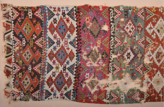This long, panel kilim was woven by a tribal group of the Reyhanli Confederation in the Gaziantep region. Early 19th Century Anatolian Reyhanlı Kilim Fragment Size 120 x 345 cm All the  ...