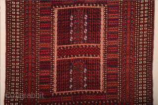 A very beautiful early example, this Saryk door rug was probably woven in the second half of the 19th century, as the quality of the drawing and comparatively light palette suggest.   ...