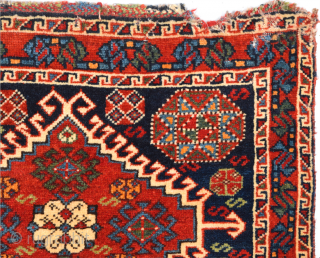 Half of a double bag by the Luri from the Fars area. The design is strongly influenced by Qashqai models, but the coarser weave, with red wool wefts, reveals the Luri origin.  ...