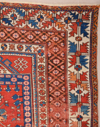 In this red-ground Late 18th Century West Anatolian Bergama, a powerful dark blue shield form encloses a large red stepped motif of almost the same size as well as a smaller, green  ...