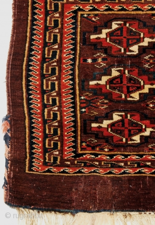 Yomut-family torba with dense,lustrous pile and a handle like an animal pelt. The knot is Asymmetric, Open Left, note the slight vertical markings in the pile also seen in Eagle-type weaving. From  ...