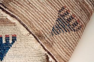 Early and archaic Karapinar prayer rug, approx 4.3 x 4.7 feet (124 x 138 cm), circa 1800-50. No reweaves. Heavy oxidation as shown.