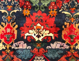 Description: magnificent Karabagh carpet. Blue background, stylized flower decoration and characters. Brick red border of knotted flower wreaths.  Dimensions: 275 cm x 166 cm  Age: early 20th century  Condition: perfect, full and regular pile