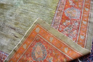 Rare and Beautiful 1900 Turkish Oushak 12'1 x 15'9, open grass green field with an amazing array of all natural colors including, reds, orange, blues, green, gray, pink and gold.  In  ...