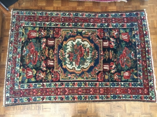 "Bakhtiari Gol Farang ""Foreign Flower"" decorative rug. 7'X 4'-5"". Very good condition with good pile. All the colors of the rainbow with no harsh colors. A decorator's delight! Minor end loss, secured,  ..."