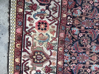 Antique Bakhtiari rug with natural dyes and all wool foundation. Areas of wear and a crease or two. No holes, or smells. About 5' X 4'. Has a small faded area -  ...