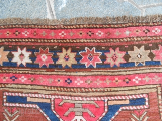 171 x 131 cm. is the size of this antique KAZAKH-Caucasus. In very good condition and