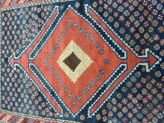 231 x 150 cm. is the size of this antique Luri. Carpet in good conditions. Original