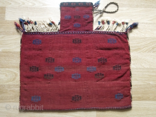 """Afshar namakdan - salt bag. Original condition with goat hair side wrapping-tassels. Natural colors. Circa 1900.  Size:65 x 63 cm (25.5"""" x 25"""")."""
