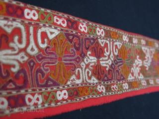 "Turkmen Chodor silk embroidered costume fragment. Adras ikat backing. Circa 1900. Size: 120 cm x 10 cm (47.2""x 3.9"")."