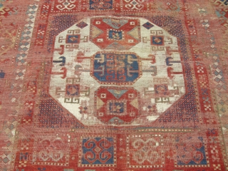A stunning early c1850 Karapchop Kazak rug. Wonderful border . Great colours. Used condition. there are some old repairs to the central medallion and the sides have been rebound some time ago  ...