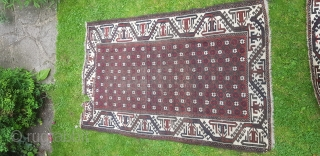 An Unusual pair of 19thc Belouch rugs. Very graphic border surrounding a rare star design field. In used condition but still retaining great charm. 4ft9x3ft each.