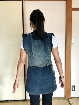 Neat little farmer's vest. Despite some holes, it is in good condition and could still be worn. The jacket is beautifully worn our be decades of physical labor on the rice fields  ...