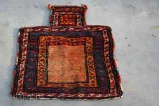 A large, 19th century Bakhtiari salt or tobacco bag with in tact and interesting back, saturated color and shiny wool.