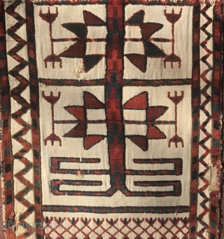 Turkmen Early 19th Century narrow tent band fragment mounted on linen with saturated color, unusual asymmetrical iconography, and shadows on the last row of flowers.