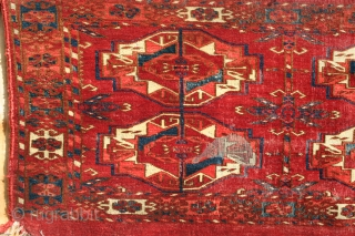 Early Tekke Torba 19th century with good color, spacious gul layout, interesting minor guls, however, moth damage, wear, and some paint on the verso. Condition is considered in the price.
