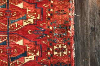 Tekke Torba 19th century with good color, spacious gul layout, moth damage, wear, and some paint on the verso.