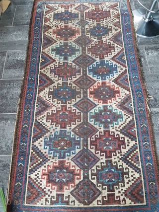 A white Memling Carpet , Baluchistan , Circa 19th , size : 196x97cm. Very nice colors and drawling , great light blue border . needs to be cleaned ,  Condition as photos here,  ...
