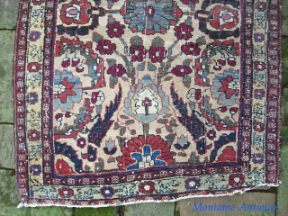 Old Persian Pushti.  24 x 34 inches. Lovely old ivory ground piece of uncertain  origin and I won't hazard a guess. Very fine weave. Double wefted on cotton foundation. Fine  ...