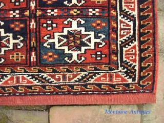 Tribal--21 x 22 inches. SW? Kurdish? Harks of a Turkoman ancestry. Fine and plush. We have just posted 40 nice fresh pieces on the web site: www.montaine-antiques.com.