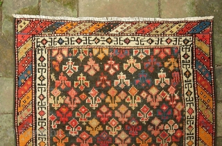 Malayer Mat. 1 ft 9 in x 2 ft. 1 inches. Cute little tiny thing with cool design and lotsa colors.  Someone spent $100 fixing the ends and sides. Sturdy, solid,  ...