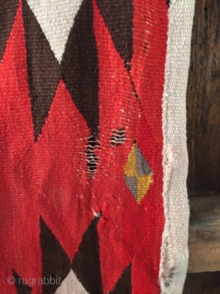 """As found: Turn of the century transitional Navajo rug measuring 4'4""""x 6'6"""" in need of service.  Ends need to be partially rewoven as well as some scattered area's in the field.  ..."""