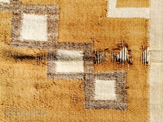 """As found: An early 20th century Navajo measuring 3'10""""x 5'7"""" with an area of 5 small holes, the largest hole being 1 and a half inch square, has some snags, one side  ..."""