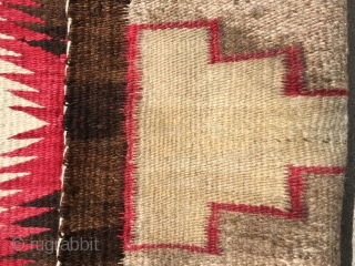 "As found: Vintage Navajo rug measuring 3'5""x 5'8"" with a stain of unknown substance in one of the ivory blocks in the middle of the rug.  Also a faint discoloration at  ..."