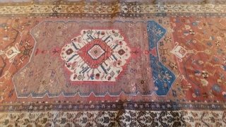 "Old NW Persian rug measuring 5'6""x 13'6"" that has been reduced in size, the two roughly 1'x 5'6"" pieces that were removed are available to put back in the rug.  Thanks  ..."