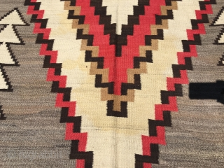 "Nice old Navajo measuring 5'x 9'5"" with 6 warps and 12 wefts per square inch with slight yellow stains in the ivory part of the medallion, lower half, with one side being  ..."