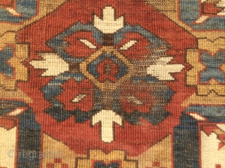 "As found: 1880's to 1900's Chelaberd rug measuring 4'8""x 9'8"" that needs service. 1.  I am pointing at 2 area's that need better wool match. 2.  one corner needs to  ..."