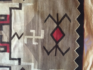 1920's-30's Navajo rug measuring 3'x 5' with a foots worth of reweaving that needs to be done on one end (maybe 2-4 rows of black border color), has a little notch on  ...