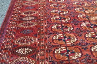 "As found: An early 20th century Turkoman carpet measuring 7'5""x 11'4"", light even wear, couple of old repairs that are hard to notice, and an area with some discoloration.  Thanks for  ..."