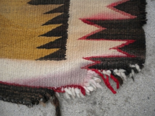 "As found: An early 20th century Navajo rug measuring 4'5""x 8'3"" with problems that you can see in the pictures.  I have removed the circular stain in the rug since posting  ..."